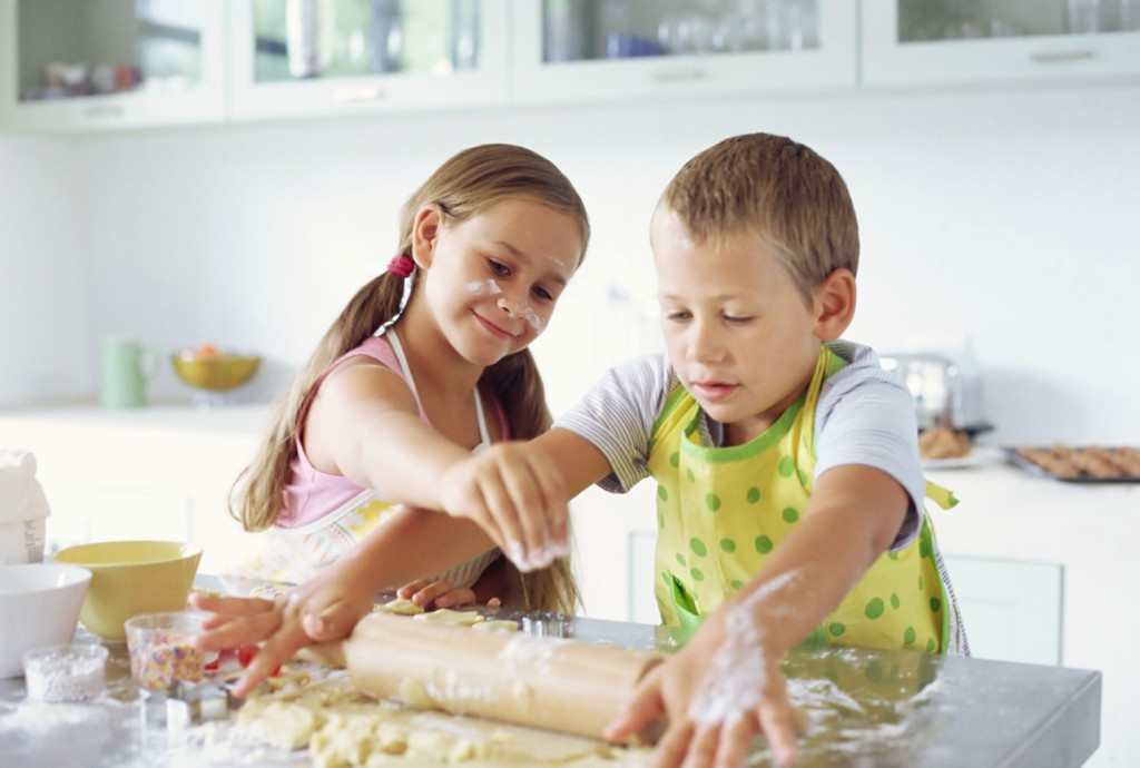 Children making biscuits --- Image by © Royalty-Free/Corbis